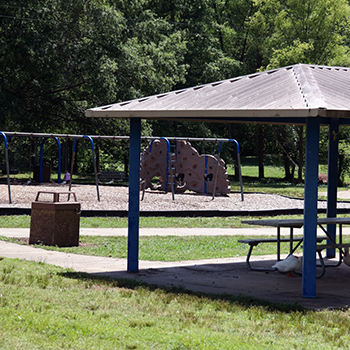 a park shelter with covered picnic area