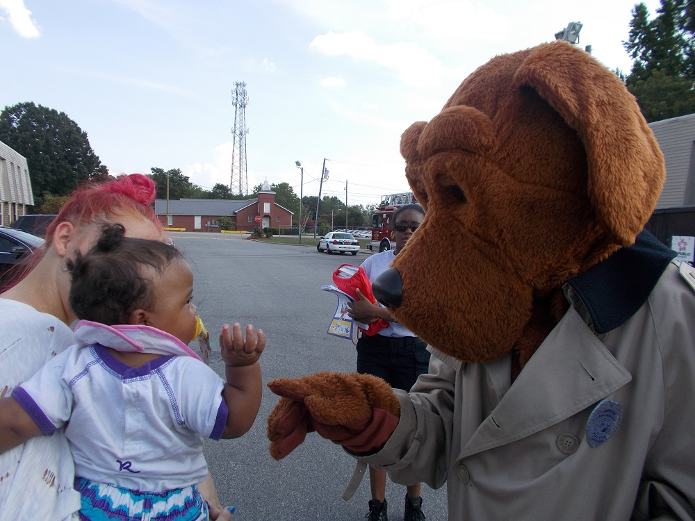 McGruff the Crime Dog meeting little kid and parent